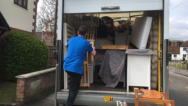 man loading van